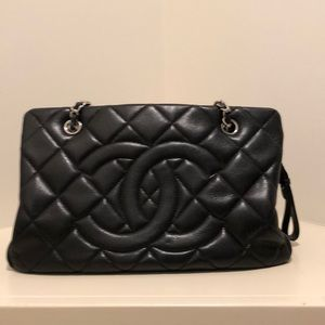 Authentic Chanel black leather handbag with chain